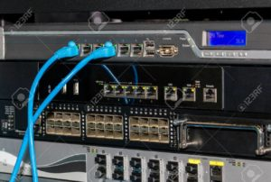 Telecommunications rack with UTP and fiber optic switchesn and firewalls